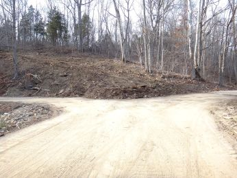 Tearing up the hillside to widen the road along the bottoms.