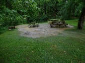 The picnic area has a stream.